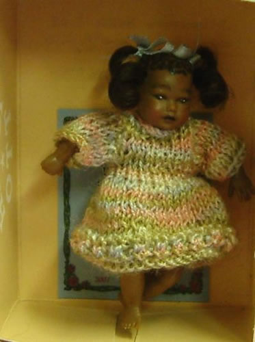 Heidi Ott Dolls House Doll, Dark Skinned Girl in a Knitted Dress (XB021)